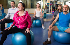 Mature men and women involved in sports gym. Active mature men and women involved in sports gym royalty free stock image