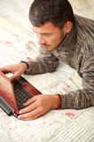 Mature men working online Royalty Free Stock Images