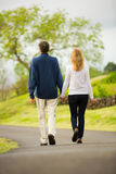 Mature middle age couple in love walking Royalty Free Stock Photos