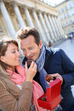 Mature middle-aged couple eating cakes in town Royalty Free Stock Photo