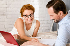 Mature middle aged couple working on the project at home Royalty Free Stock Images
