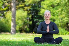 Mature Middle Aged Fit Healthy Woman Practicing Yoga Outside Stock Image
