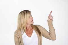 Mature Model Pointing Royalty Free Stock Image