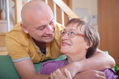 Mature mother with adult son royalty free stock photography