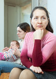 Mature mother against daughter with baby after quarrel Stock Photography