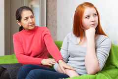 Mature mother asks for forgiveness from daughter Stock Images