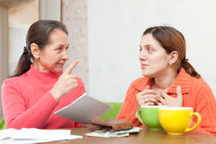 Mature mother berates adult daughter Royalty Free Stock Photos