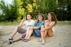 Mature mother with children having chocolate bar Royalty Free Stock Photos