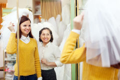 Mature mother  with daughter chooses wedding outfit Stock Image