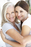 Mature Mother And Daughter Hugging Stock Images