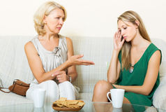 Mature mother and daughter talking Royalty Free Stock Photo