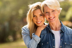 Mature mother and daughter. Mature mother and young daughter looking at the camera Royalty Free Stock Photo
