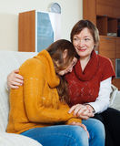 Mature  mother gives solace to crying adult daughter Royalty Free Stock Photography