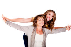 Mature mother with her daughter, indoors Stock Images