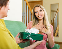 Mature mother presenting gift in box to  girl Stock Images