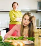 Mature mother and sad adult daughter having quarrel Royalty Free Stock Photos