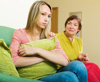Mature mother tries reconcile with adult daughter Stock Photo