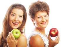 Mature mother and yung daughter with apples Royalty Free Stock Image