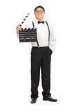 Mature movie director holding a clapperboard Royalty Free Stock Image