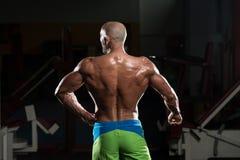 Mature Muscular Man Flexing Muscles Stock Images