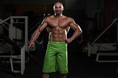 Mature Muscular Man Flexing Muscles Stock Photo