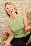 Mature Natural Woman. Natural senior woman smiling in a natural interior Stock Images