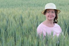 Mature natural woman in the wheat fields.  Stock Photography