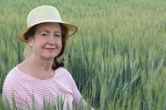Mature natural woman in the wheat fields.  Stock Images