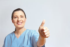 Mature nurse thumbs up copyspace Stock Image