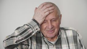 Mature old elderly man has a headache at home health problem retirement time 4k stock footage