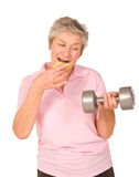Mature older lady choosing diet or exercise. Mature older lady choosing between diet or exercise, isolated on white background royalty free stock images