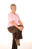 Mature older lady stretching Stock Photography