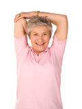Mature older lady stretching. Mature older lady performing stretching exercises before gym workout Royalty Free Stock Photos