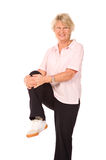 Mature older lady stretching Royalty Free Stock Images