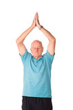 Mature older man doing yoga Royalty Free Stock Photo