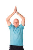 Mature older man doing yoga Stock Photos