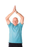 Mature older man doing yoga. Mature older man performing yoga, isolated on white background stock photos