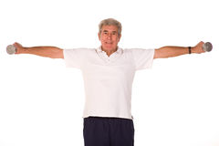 Mature older man lifting weights Royalty Free Stock Photos