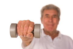 Mature older man lifting weights Royalty Free Stock Photography