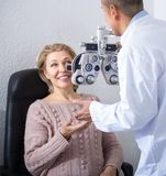 Mature optician examinating eyesight Stock Photos