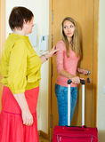 Mature owner of apartment turning female lodger out Stock Photography