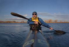 Mature paddler in a narrow racing kayak Stock Photography