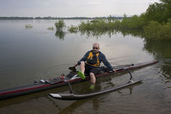 Mature paddler in racing outrigger canoe Stock Photo