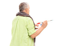 Mature painter holding a paintbrush Stock Images