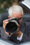 Mature paparazzi taking picture Stock Photos