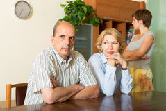 Mature parents with daughter having conflict. In home interior stock photos