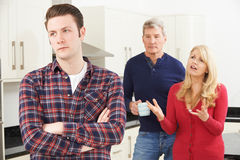Mature Parents Frustrated With Adult Son Living At Home Stock Photography