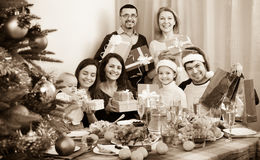 Mature parents with kids celebrating Merry Christmas. Mature parents with adult kids and grandchildren celebrating Merry Christmas royalty free stock photography