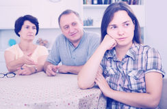 Mature parents listening to daughter and trying to help Stock Image