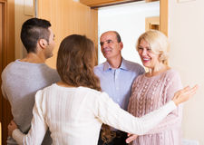 Mature people coming to visit adult kids Royalty Free Stock Photos